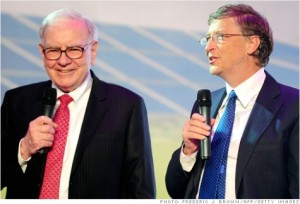 TO GO WITH Lifestyle-India-poverty-charity-US-Gates-Buffett,ADVANCER by Penny MacRae (FILES) In this photograph taken on September 29, 2010, leading US businessmen Warren Buffett (L) and Bill Gates (R) speak at the nationwide launch ceremony of Chinese electric vehicle BYD M6 in Beijing. Two of the world's richest men, software czar Bill Gates and investor Warren Buffett, are set to visit India this week to persuade the country's super-wealthy to part with more of their money.  AFP PHOTO/Frederic J. BROWN/FILES (Photo credit should read FREDERIC J. BROWN/AFP/Getty Images)